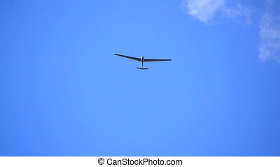 Glider isolated against blue sky