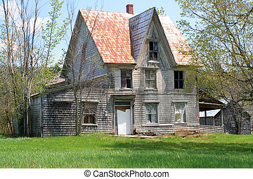 haunted house - spooky, broken down, abandoned house in a...