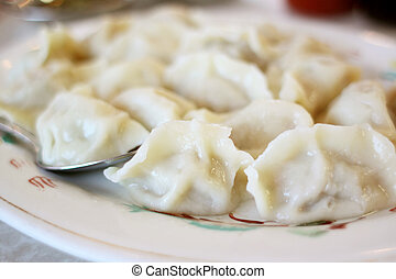 Plate of steamed potstickers - Plate of potstickers at a...