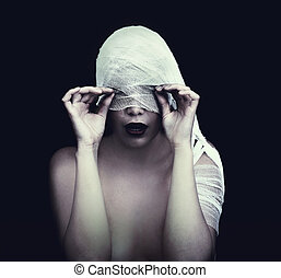 woman in bandage over black background (gothic style...