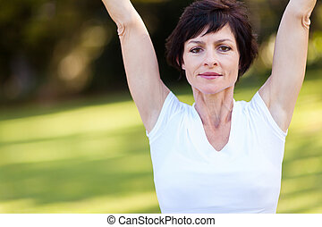 middle aged woman stretching exercise