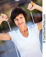 middle aged woman with jumping rope - active middle aged...