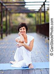 fit middle aged woman portrait outdoors