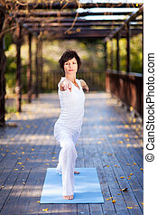 middle aged woman doing exercise