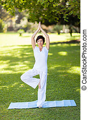 middle aged woman doing yoga - beautiful middle aged woman...
