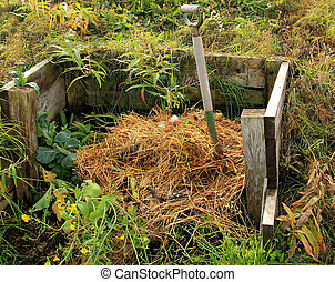 Compost Pile - Rural compost pile in a rustic board frame...