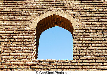 Arched Window in Brick Wall - An ancient arched window in...