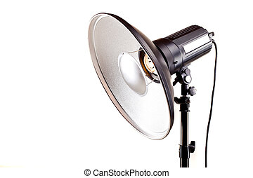 studio monoblock flash light on tripod isolated on white...