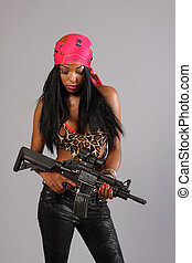 Woman with gun - Sexy young woman with an assault rifle