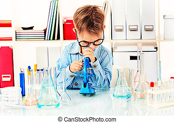 bacterium - Cute boy is making science experiments in a...