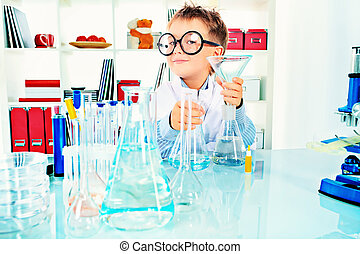 molecule - Cute boy is making science experiments in a...