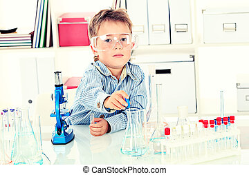 learning - Cute boy is making science experiments in a...