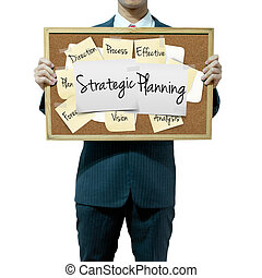 Business man holding board on the background, Strategic Planning concept