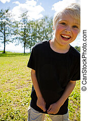 Boy outdoors - Portrait of a boy outdoors on a beautiful...