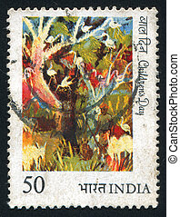 painting of birds in trees - INDIA - CIRCA 1984: stamp...