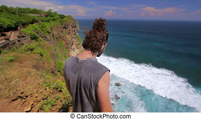man at the edge of cliff