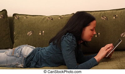 teenage girl play with tablet