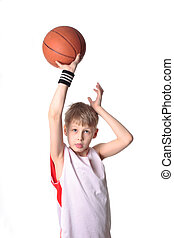 basketball boy - A 10 year old boy concentrating before a...