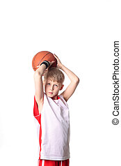 basketball player - A 10 year old boy concentrating before a...