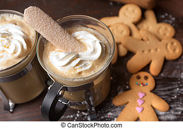 Christmas coffee - Gingerbread men cookie biscuits with hot...