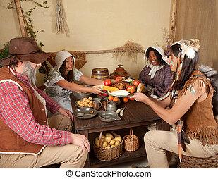 Thanksgiving pilgrims eating - Reenactment scene of the...
