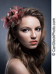 Art portrait of young attractive girl with bow close up
