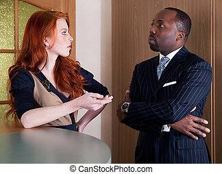 Business team - red head freckled pretty lady and black man...