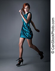 Sexy fashion sporty beauty girl runing in blue dress