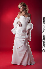 Wedding fashion model blonde in bridal dress - series of photos