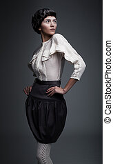 Fashionable beautiful woman in black and white retro clothes...