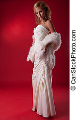 Bride fashion model in wedding dress on podium standing -...