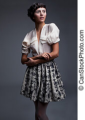 Lovely aristocratic fashion model in retro clothes posing -...