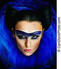 Imposing young lady with bright make up closeup portrait -...