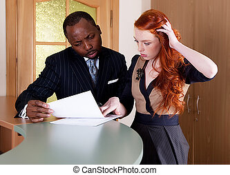Negotiations between red-haired girl and black american man...