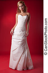 Pretty female - young bride blonde in wedding white dress -...