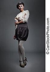 Lovely fashion model girl in retro black skirt, white shirt...