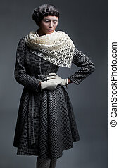 Fashion model in retro garments - white shawl, gloves and...
