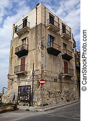 Old house in Cefalu. - An old house with balconys and street...