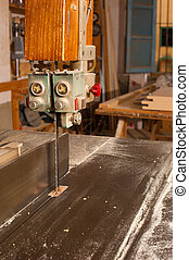 Bandsaw - Detail take of a bandsaw against the background of...