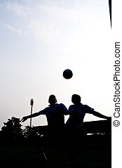 Heading for goal - silhouette of football player heading for...