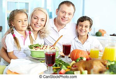 Festivity - Portrait of happy family sitting at festive...