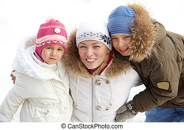 Family of three - Happy kids and their mother in winterwear...