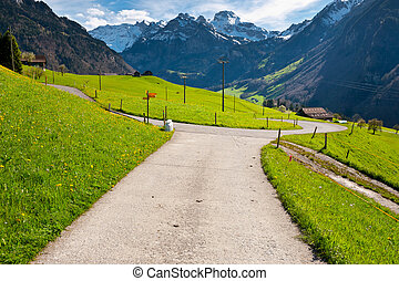 Milk Cans at the Crossroads High Up in the Swiss Alps