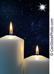 Two candles with Star of Bethlehem - closeup Two candles...