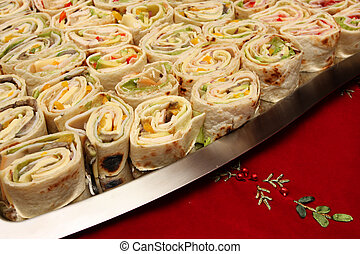 mexican food - a plate full of snack sized mexican wraps