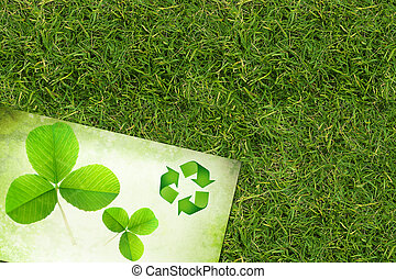 Grass background - Ecology background with recycling symbol...