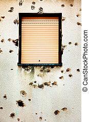 Bullet holes in a house facade