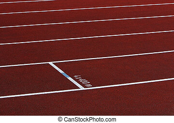 multiple tracks - multiple lanes on a red running track with...