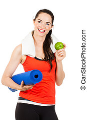Fit woman with yoga mat and apple - A fit, healthy happy...