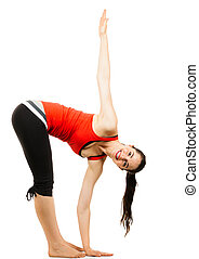 Happy woman doing a yoga stretch - A happy healthy beautiful...